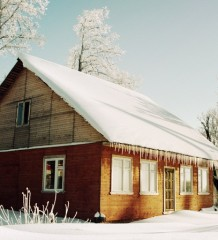 Winter Home - a house in the winter landscape.