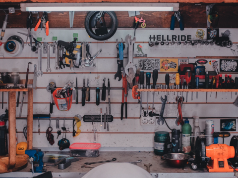 a wall of tools at a repair shop