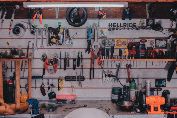 a wall of tools at a repair shop